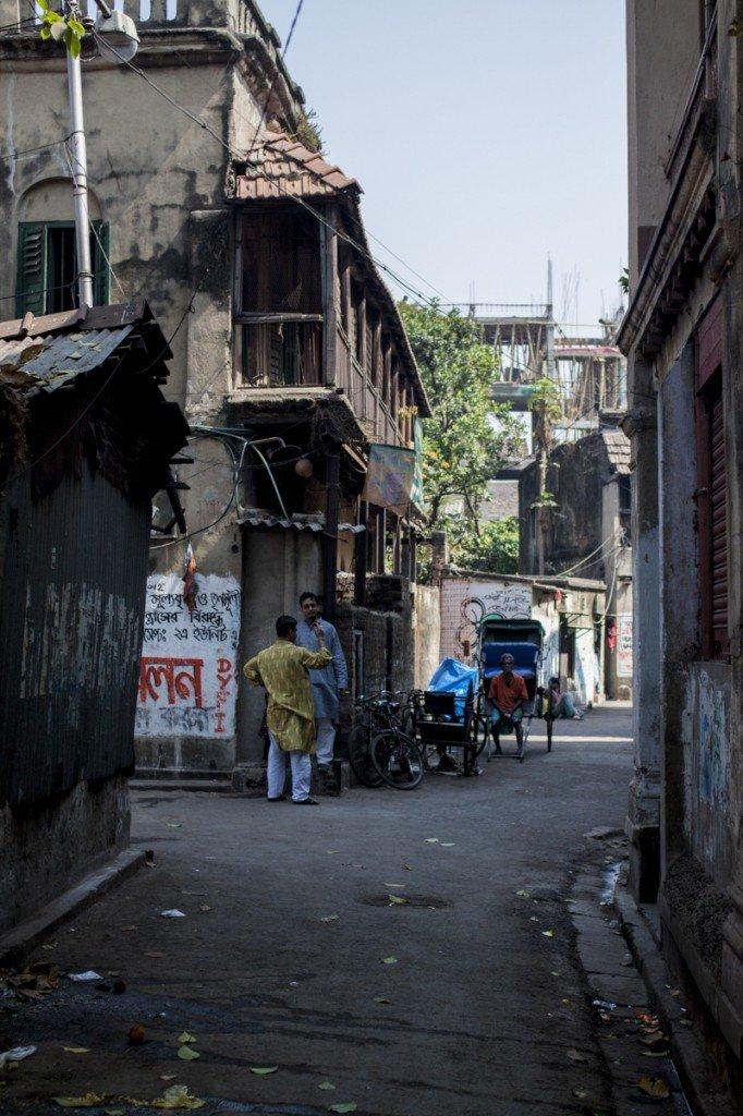 Calcutta Alleyway with rickshaws