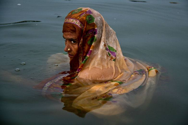 Varanasi woman bathing ganges