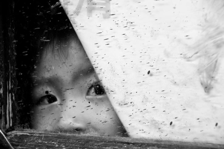 boy window hutong beijing