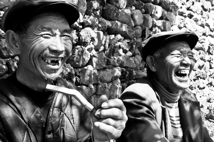 men laughing hutong