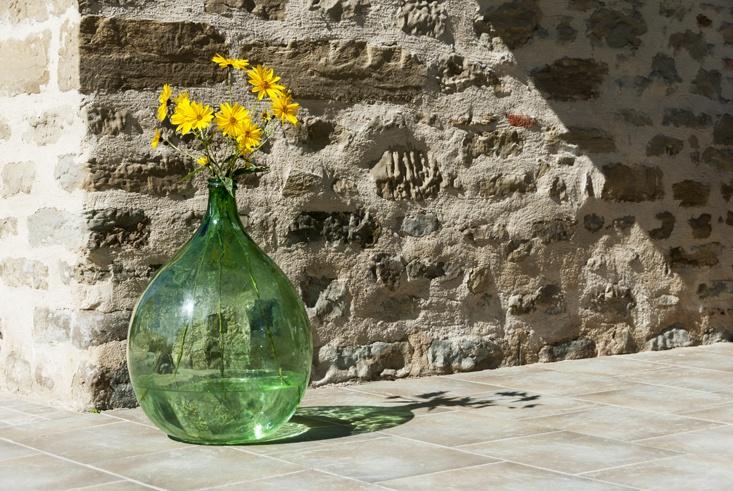 yellow flowers green round bottle