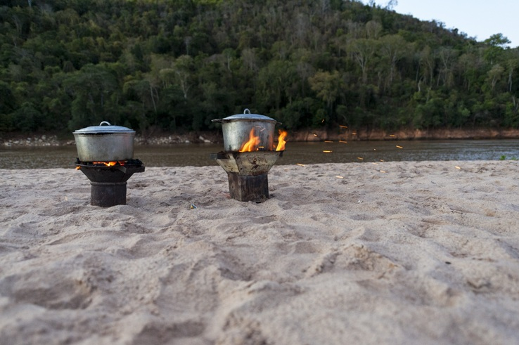 pots on fire near river
