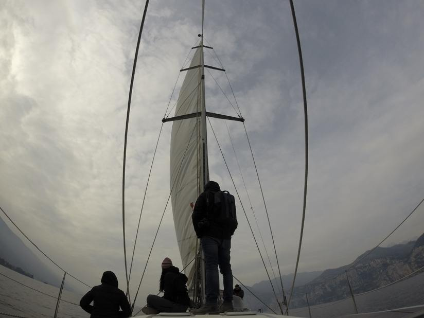 lake garda sailboat clouds