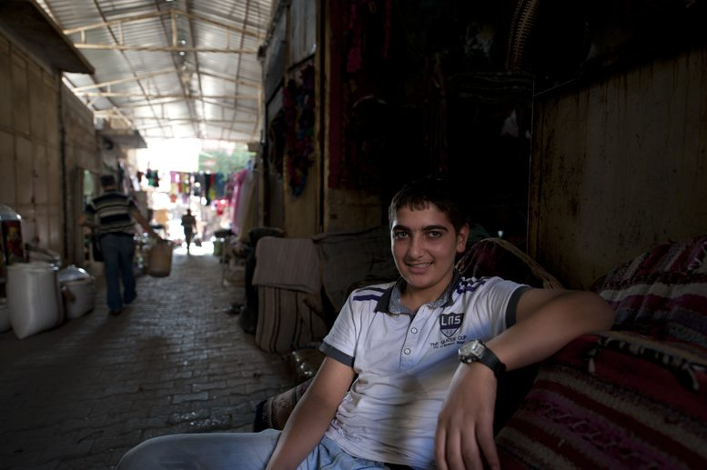 boy in souk silk road travel