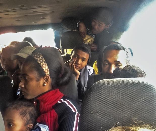 overloaded bush taxi inside
