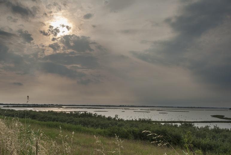 sunset comacchio lagoon
