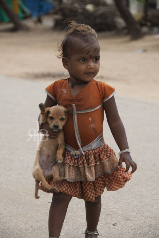 Hampi girl with puppy