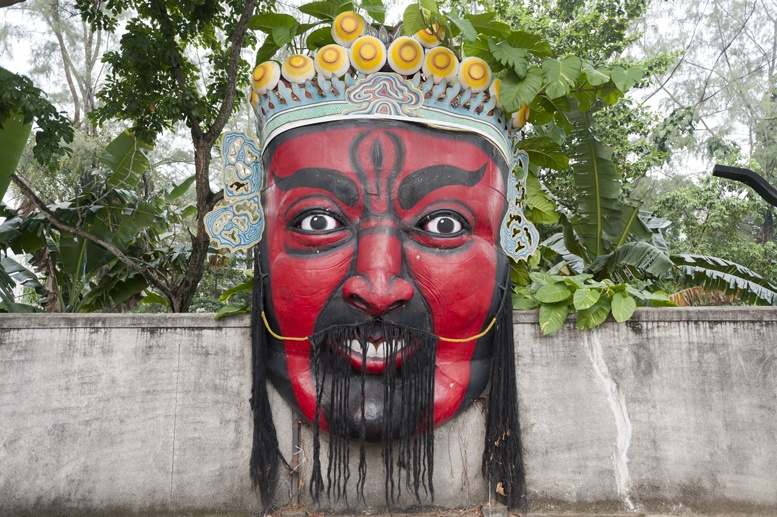 haw par villa singapore big red mask