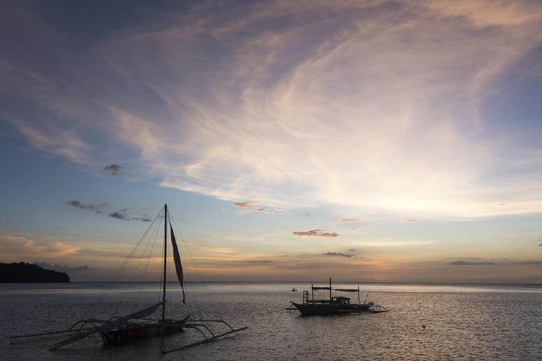 danjugan island boat cloud sunset