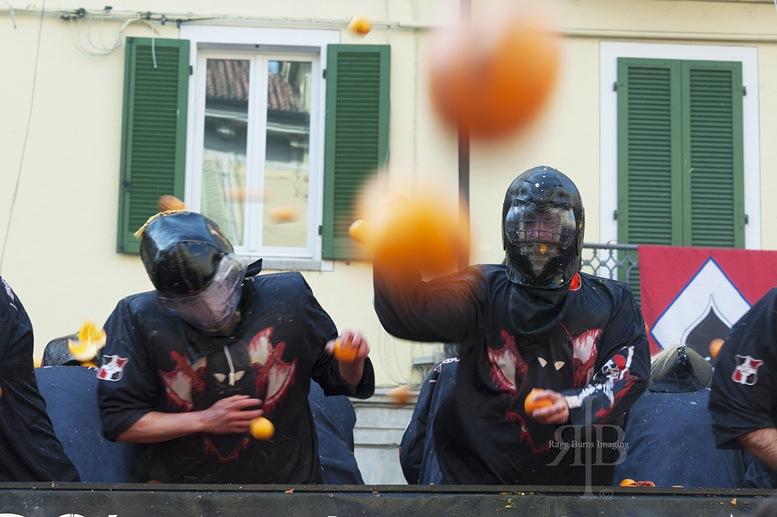 ivrea carnival oranges flying