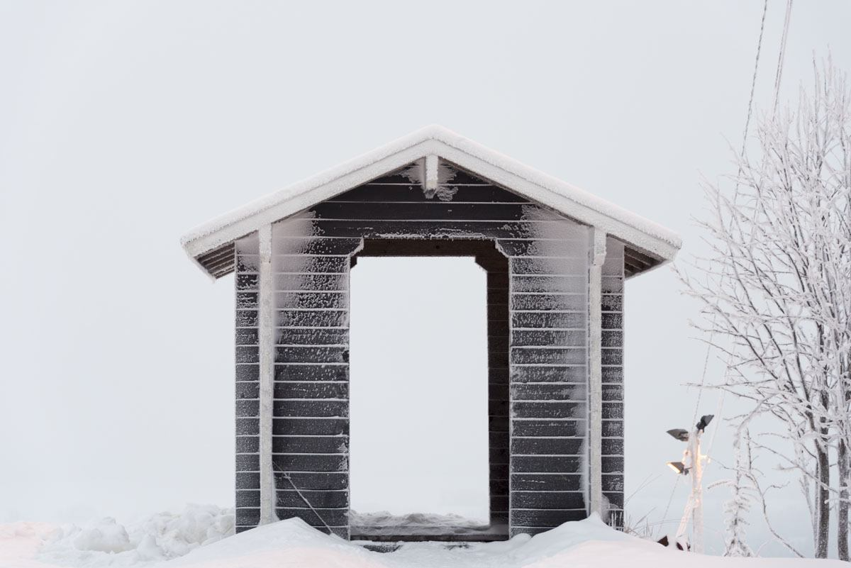 small cabin in snow finland