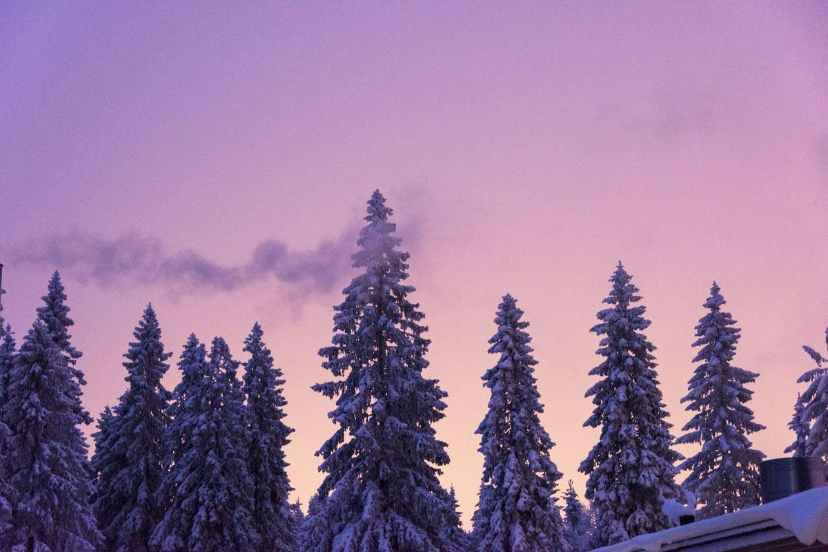 skiing in finland purple sky