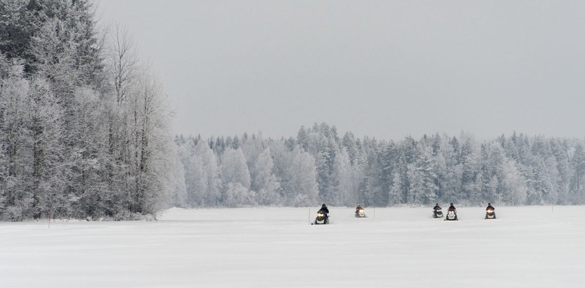 frozen lake finland snowmobile