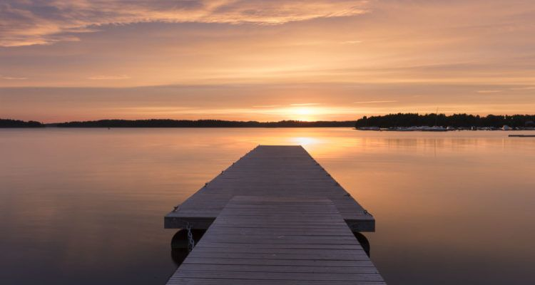 visit lohja finland lake sunset pier