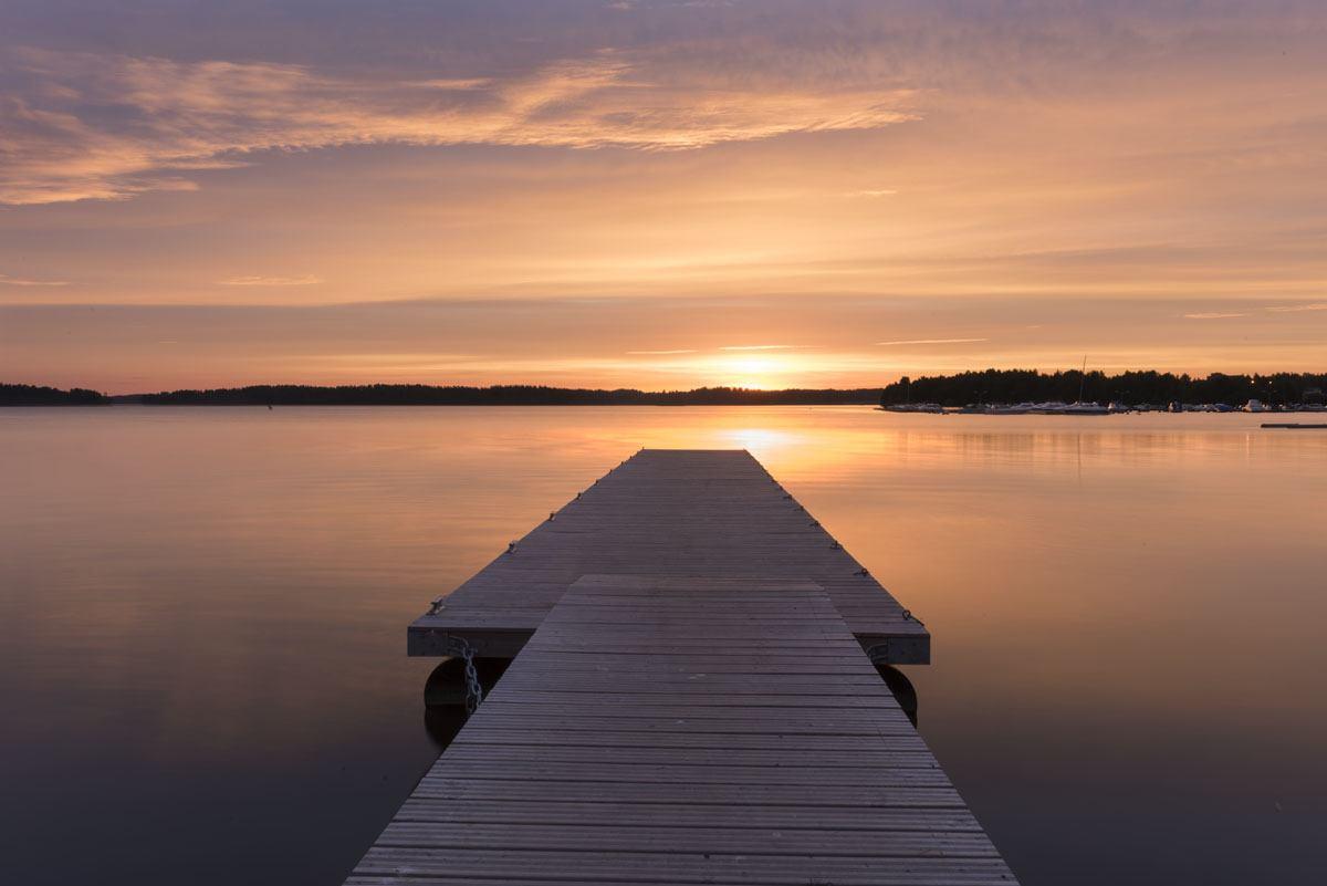 visit lohja finland lake sunset pier