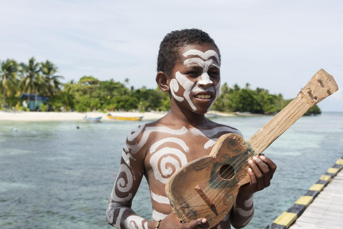 arborek-village-raja-ampat-boy-guitar