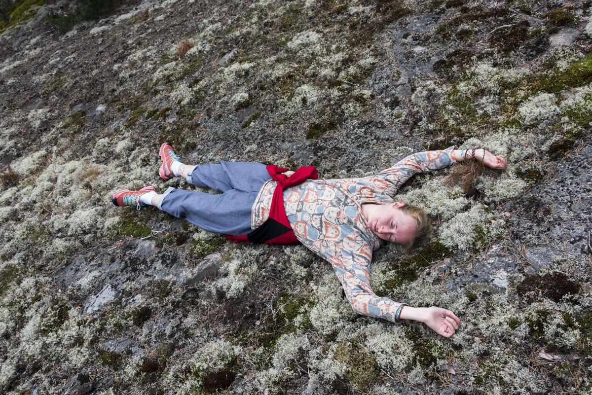 girl lying on rocks