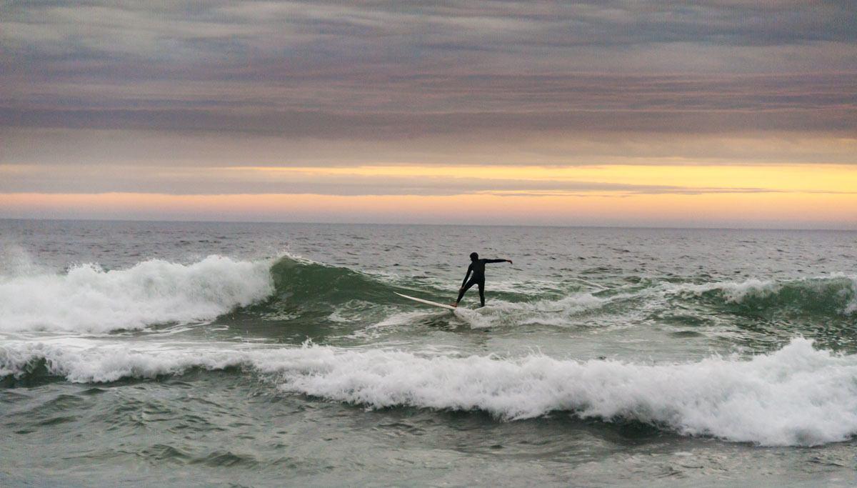 cape peninsula surfer sunset