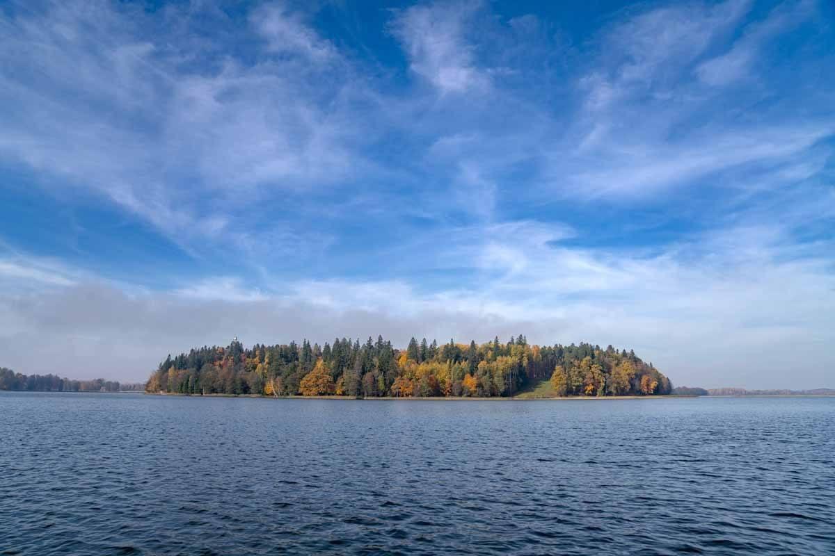 aluksne lake island blue sky