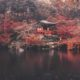 Panorama of Daigo ji temple with asian traveler woman and umbrella against colorful red maple tree in autumn season, Kyoto, Japan